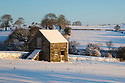 Stone field barn following heavy snowfall. Bonsall, Peak District Natioanl Park, Derbyshire. December.