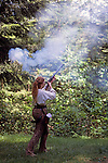 Fort Clatsop National Memorial Lewis and Clark wintered in 1806-1806 historical reenactment of a settler firing a musket Astoria Oregon State USA