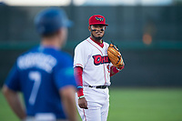Orem Owlz third baseman Kevin Maitan (9) talks to Raptors manager Jeremy Rodriguez (7) during a Pioneer League game against the Ogden Raptors at Home of the OWLZ on August 24, 2018 in Orem, Utah. The Ogden Raptors defeated the Orem Owlz by a score of 13-5. (Zachary Lucy/Four Seam Images)