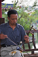 A man playing the Chinese opera fiddle in a park, Rong Lake, Guilin, China, Asia