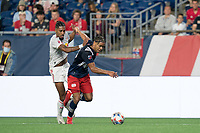 FOXBOROUGH, MA - JUNE 23: Brando Bye #15 of New England Revolution gets ball from Fabio Gomes #9 of New York Red Bulls during a game between New York Red Bulls and New England Revolution at Gillette Stadium on June 23, 2021 in Foxborough, Massachusetts.