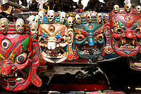 Masks of Buddhist protector deities at a market stall on the Barkhor pilgrim circuit, Lhasa, Tibet.