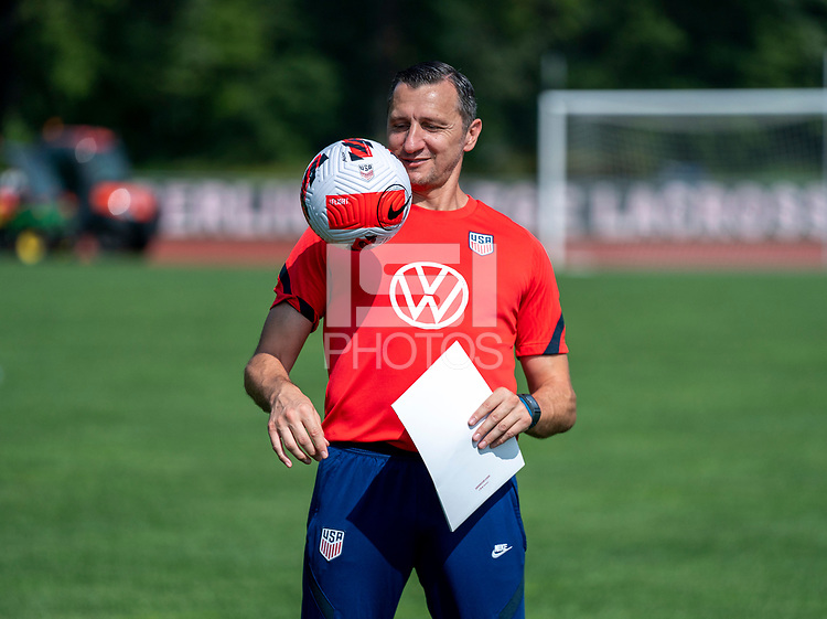 CLEVELAND, OH - SEPTEMBER 14: Vlatko Andonovski of the United States juggles the ball after a training session at the training fields on September 14, 2021 in Cleveland, Ohio.