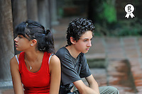 Teenager girl and boy (14-15) looking away (Licence this image exclusively with Getty: http://www.gettyimages.com/detail/93522424 )