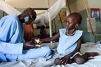 SOUTH SUDAN  Bahr al Ghazal region , Lakes State, hospital of Comboni Missionaries in village Mapuordit, children are treated of malaria / SUED-SUDAN  Bahr el Ghazal region , Lakes State, Mary Immaculate DOR Hospital der Comboni Missionare im Dinka Dorf Mapuordit , Maedchen wird wegen Malaria behandelt