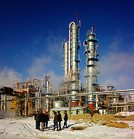 China, Manchuria.  Site meeting in sub-zero temperatures during the construction of petrochemical plant at Daqing, site of China's largest oil field.  Oil refinery..