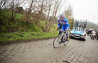 Bjorn Leukemans (BEL) returning back to the leading peloton after a mechanical<br /> <br /> Omloop Het Nieuwsblad 2014