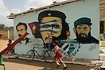 school with mural politics billboards about Castro and El Che