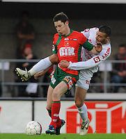 SV Zulte-Waregem - KV Kortrijk..Thomas Matton aan de bal met aan zich Salah Bakour (rechts) hangen...foto David Catry /VDB