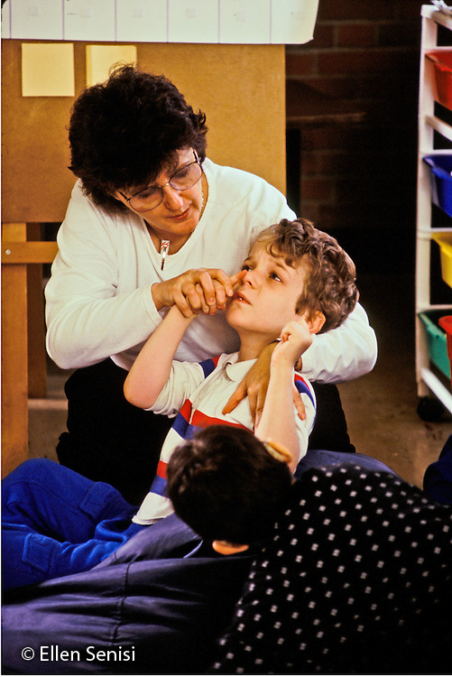 MR / Schenectady, NY.Yates Arts Magnet School / Special Education Class.Speech teacher works with boy (7, autistic) naming facial features..MR: Cou1, Fis1.PN#: 14854                     FC#: 21606-00101.scan from slide.©Ellen B. Senisi