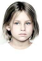 blonde girl with blue eyes wears white shirt