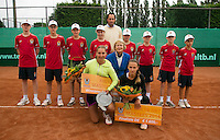 August 17, 2014, Netherlands, Raalte, TV Ramele, Tennis, National Championships, NRTK,  womans final:  prize giving runner up Olga Kalyuzhnaya end winner Danielle Harmsen (yellow) in the middle Marja Bongers and Floris Kilian<br /> Photo: Tennisimages/Henk Koster