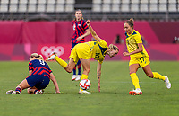 KASHIMA, JAPAN - AUGUST 5: Emily van Egmond #10 of Australia is tackled by Lindsey Horan #9 of the USWNT during a game between Australia and USWNT at Kashima Soccer Stadium on August 5, 2021 in Kashima, Japan.
