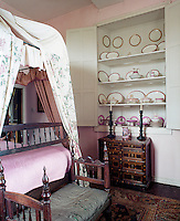 A cabinet in one of the bedrooms hides a collection of antique porcelain dinnerware