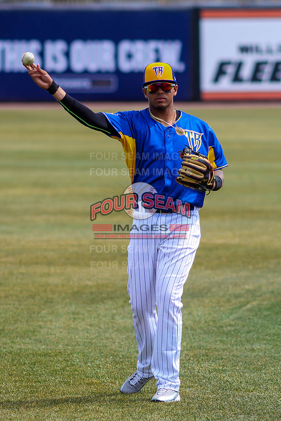 Wisconsin Timber Rattlers shortstop Gilbert Lara (11) warms up prior to a Midwest League game against the Quad Cities River Bandits on April 9, 2017 at Fox Cities Stadium in Appleton, Wisconsin.  Quad Cities defeated Wisconsin 17-11. (Brad Krause/Four Seam Images)