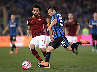 Calcio, Serie A: Roma vs Inter. Roma, stadio Olimpico, 19 marzo 2016.<br /> FC Inter's Yuto Nagatomo, left, is challenged by Roma's Mohamed Salah during the Italian Serie A football match between Roma and FC Inter at Rome's Olympic stadium, 19 March 2016. The game ended 1-1.<br /> UPDATE IMAGES PRESS/Isabella Bonotto