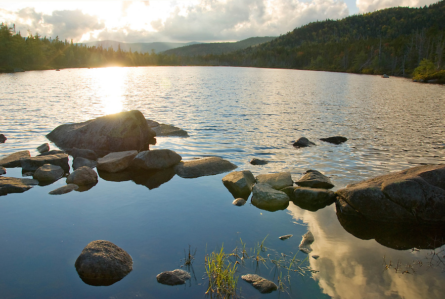 The end of the day is close at hand in this summer scene from Ethan Pond.