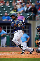 San Antonio Missions outfielder Yeison Asencio (14) at bat during a game against the NW Arkansas Naturals on May 30, 2015 at Arvest Ballpark in Springdale, Arkansas.  San Antonio defeated NW Arkansas 5-2.  (Mike Janes/Four Seam Images)