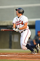 Danville Braves catcher Phillip Britton watches the flight of his solo home run in the bottom of the second inning versus the Greeneville Astros at American Legion Field in Danville, VA, Saturday, July 1, 2006.