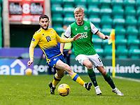 1st May 2021; Easter Road, Edinburgh, Scotland; Scottish Premiership Football, Hibernian versus St Johnstone;  Josh Doig of Hibernian pushes ball past Craig Conway of St Johnstone