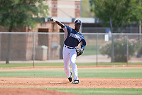 AZL Padres 1 third baseman Carlos Luis (25) throws to first base during an Arizona League game against the AZL Royals at Peoria Sports Complex on July 4, 2018 in Peoria, Arizona. The AZL Royals defeated the AZL Padres 1 5-4. (Zachary Lucy/Four Seam Images)