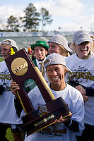 Julie Scheidler (25) of Notre Dame holds the trophy after the final of the NCAA Women's College Cup at WakeMed Soccer Park in Cary, NC.  Notre Dame defeated Stanford, 1-0.