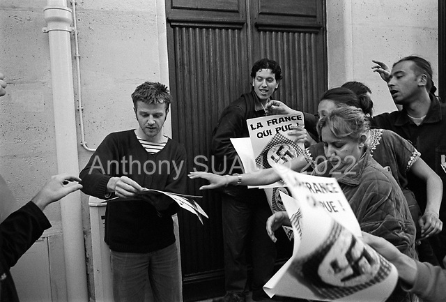 Paris, France.April 23, 2002..A protesters distributes printed anti-Nazi / anti-National front / anti-Le Pen signs to use in street demonstrations.