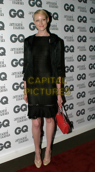 JADE PARFITT.The 8th Anual GQ Men of The Year Awards,.The Royal Opera House,.London, 6th September 2005.full length black jacket skirt red handbag purse .www.capitalpictures.com.sales@capitalpictures.com.© Capital Pictures.