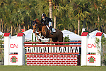 Mario Deslauriers of Canada and Paradigm placed eighth in the inaugural $50,000 CN Palm Beach Jumping Derby on Sunday, Feb. 15 at the Stadium at Palm Beach International Equestrian Center in Wellington, Fla. Olympic gold medalist Beezie Madden and Play On bested 33 other starters from seven countries, including Olympic gold medalists Leslie Howard of the United States, Eric Lamaze of Canada and Rodrigo Pessoa of Brazil, winning $14,000. Peter Leone and Sequoyah's Ado Annie were second and Eric Lamaze Lord du Janue were third, winning $11,000 and $6,500, respectively. Deslauriers collected a $1,500 check for his performance. Formerly the site of Palm Beach Polo Stadium - made famous by the world's best polo players, steeplechase competitors and celebrities including Prince Charles and Princess Diana - the field came alive with a new derby course not often seen in the U.S. Part of the FTI Winter Equestrian Festival, the competition highlighted a type of show jumping popular in Europe. Nineteen natural obstacles and grand prix fences - including a double liverpool, water jump and a hedge - were mixed on a spread out course designed by Richard Jeffery of Great Britain, with extensive room between jumps. Photo by Bob Markey II.