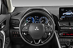 Car pictures of steering wheel view of a 2021 Mitsubishi Eclipse-Cross-PHEV Invite 5 Door SUV Steering Wheel
