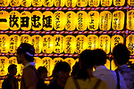 July 13, 2014, Tokyo, Japan - Visitors enjoy the view of the lanterns during the annual Mitama festival at Yasukuni Shrine on July 13, 2014. The festival celebrates the spirits of lost ancestors and is held across Japan in early July. There are over 30,000 lanterns lining the path to the shrine to help spirits find their way during the festival. Yasukuni Shrine is also the place where more than 2.4 million war dead are enshrined.This year the festival is held from July 13 to 16. (Photo by Rodrigo Reyes Marin/AFLO)