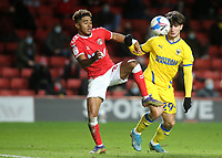 Ian Maatsen of Charlton Athletic and AFC Wimbledon's Ryan Longman challenge for the ball during Charlton Athletic vs AFC Wimbledon, Sky Bet EFL League 1 Football at The Valley on 12th December 2020