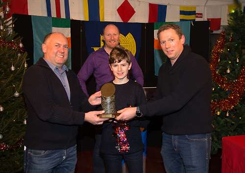 Fergal Lyons presenting Cian and Rian Baynes of Joker, winners of the Oyster Festival Race Galway Bay Sailing Club