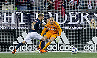 Foxborough, Massachusetts - April 6, 2018: In a Major League Soccer (MLS) match, New England Revolution (blue/white) defeated,4-0, Montreal Impact (white), at Gillette Stadium.<br /> Diego Fagundez works and scores.