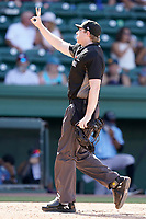Umpire Mitch Leikam works a game between the Hickory Crawdads and the Greenville Drive on Sunday, August 29, 2021, at Fluor Field at the West End in Greenville, South Carolina. (Tom Priddy/Four Seam Images)