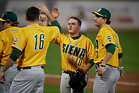 Siena Saints Alex Milone (10) high fives teammates including Jonathan Crimmin (16) and Nick Melillo (23) during a game against the UCF Knights on February 14, 2020 at John Euliano Park in Orlando, Florida.  UCF defeated Siena 2-1.  (Mike Janes/Four Seam Images)