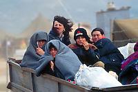 - refugees from Kosovo come down with tractors from Morini pass to the city of Kukes....- profughi dal Kossovo scendono sui trattori dal passo di Morini alla città di Kukes