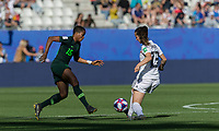 GRENOBLE, FRANCE - JUNE 22: Sara Daebritz #13 of the German National Team blocks Rasheedat Ajibade #15 of the Nigerian National Team pass during a game between Panama and Guyana at Stade des Alpes on June 22, 2019 in Grenoble, France.