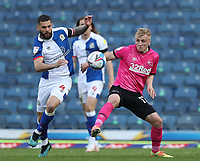 16th April 2021; Ewood Park, Blackburn, Lancashire, England; English Football League Championship Football, Blackburn Rovers versus Derby County; Bradley Johnson of Blackburn Rovers and Louie Sibley of Derby County compete for the ball