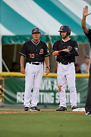 Batavia Muckdogs manager Tom Lawless (10) and J.D. Orr (22) during a NY-Penn League game against the Lowell Spinners on July 10, 2019 at Dwyer Stadium in Batavia, New York.  Batavia defeated Lowell 8-6.  (Mike Janes/Four Seam Images)