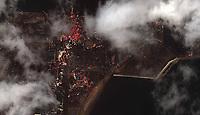 Earthquake and Tsunami damage, Japan-March 12, 2011: This is a satellite image of Japan showing damage after an Earthquake and Tsunami at the Sendai Port, Japan. (credit: DigitalGlobe) www.digitalglobe.com