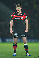 20121216 Copyright onEdition 2012©.Free for editorial use image, please credit: onEdition..Owen Farrell of Saracens looks on during the Heineken Cup Round 4 match between Saracens and Munster Rugby at Vicarage Road on Sunday 16th December 2012 (Photo by Rob Munro)..For press contacts contact: Sam Feasey at brandRapport on M: +44 (0)7717 757114 E: SFeasey@brand-rapport.com..If you require a higher resolution image or you have any other onEdition photographic enquiries, please contact onEdition on 0845 900 2 900 or email info@onEdition.com.This image is copyright onEdition 2012©..This image has been supplied by onEdition and must be credited onEdition. The author is asserting his full Moral rights in relation to the publication of this image. Rights for onward transmission of any image or file is not granted or implied. Changing or deleting Copyright information is illegal as specified in the Copyright, Design and Patents Act 1988. If you are in any way unsure of your right to publish this image please contact onEdition on 0845 900 2 900 or email info@onEdition.com