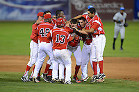 Batavia Muckdogs infielder J.T. Riddle (5) is mobbed by teammates including CoCo Johnson (49), Avery Romero (13), Connor Burke (16), and Carlos Lopez (36) after a walk off hit during a game against the Hudson Valley Renegades on August 6, 2013 at Dwyer Stadium in Batavia, New York.  Batavia defeated Hudson Valley 4-3.  (Mike Janes/Four Seam Images)