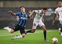 21st August 2020, Rheinenergiestadion, Cologne, Germany; Europa League Cup final Sevilla versus Inter Milan;  Lautaro Martinez of Inter Milan and Jesus Navas of Sevilla FC challenge for the ball