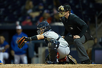 Gwinnett Braves catcher Raffy Lopez (53) frames a pitch as home plate umpire Richard Riley looks on during the game against the Durham Bulls at Durham Bulls Athletic Park on April 20, 2019 in Durham, North Carolina. The Bulls defeated the Braves 3-2 in game two of a double-header. (Brian Westerholt/Four Seam Images)
