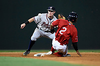 Shortstop Marcus Mooney (2) of the Rome Braves takes a throw too late as Santiago Espinal (2) of the Greenville Drive steals second in a game on Saturday, August 12, 2017, at Fluor Field at the West End in Greenville, South Carolina. Rome won, 4-0. (Tom Priddy/Four Seam Images)
