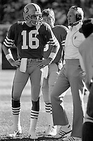 SAN FRANCISCO, CA - Quarterback Joe Montana of the San Francisco 49ers talks to head coach Bill Walsh during a game against the St. Louis Cardinals at Candlestick Park in San Francisco, California in 1986. Photo by Brad Mangin