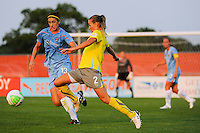Heather Mitts (2) of the Philadelphia Independence plays the ball plays the ball in front of Yael Averbuch (13) of Sky Blue FC. The Philadelphia Independence defeated Sky Blue FC 4-1 during a Women's Professional Soccer (WPS) match at Yurcak Field in Piscataway, NJ, on June 19, 2010.