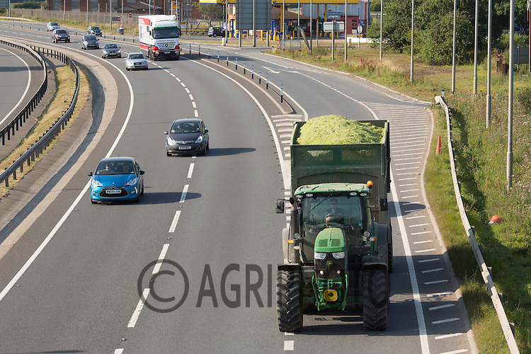 Farm tractor and trailer travelling on the A1 in Lincolnshire<br /> Picture Tim Scrivener 07850 303986<br /> ….Covering agriculture in the UK….