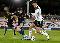 13th March 2021, Craven Cottage, London, England;  Fulhams Antonee Robinson takes on Manchester Citys John Stones during the English Premier League match between Fulham and Manchester City at Craven Cottage in London